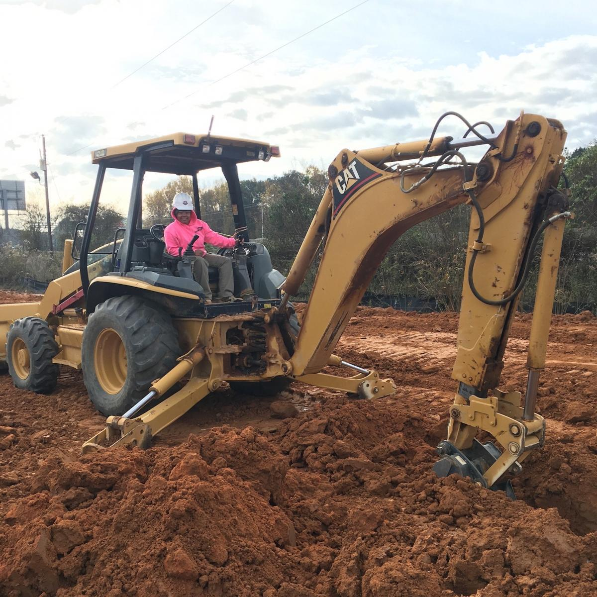 Mecah's comfort with heavy machinery proved useful for her internship