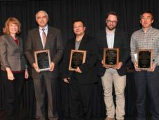 Members of the Intelligent Sprayer Development and Testing Team Receive their award from Dean Cathann A. Kress