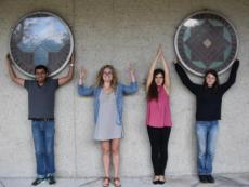 """FABE Graduate Students give an """"OHIO"""" outside the Ag Engineering Building"""