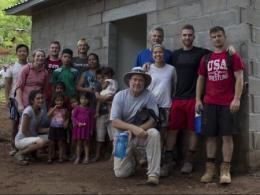 The OSU team in front of the newly built house