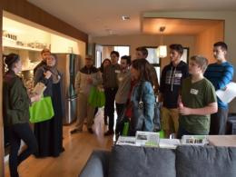 The team conducts a tour of the ENCORE House, which features many passive and active design strategies to minimize energy losses, while maximizing energy efficiency