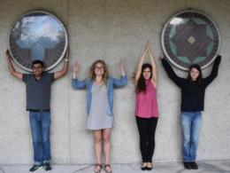"FABE Graduate Students give an ""OHIO"" outside the Ag Engineering Building"