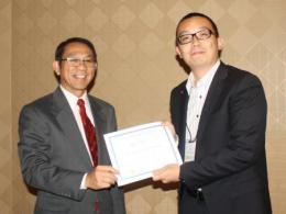 Tony Ren receiving his award